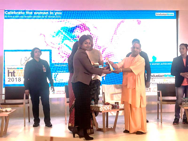 edSamaan's Founder-CMD being awarded by the CM of UP, Shree Yogi Adityanath for her pioneering work in healthcare at the HT Woman Awards 2018